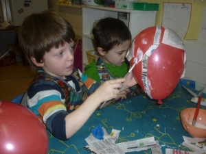 The children are right in the middle of a fantastic learning plan, exploring space. They have been learning the names of all the planets and  have made a space centre to play in. Here are Jack and Dathan using papier mache to make models of the planets..........