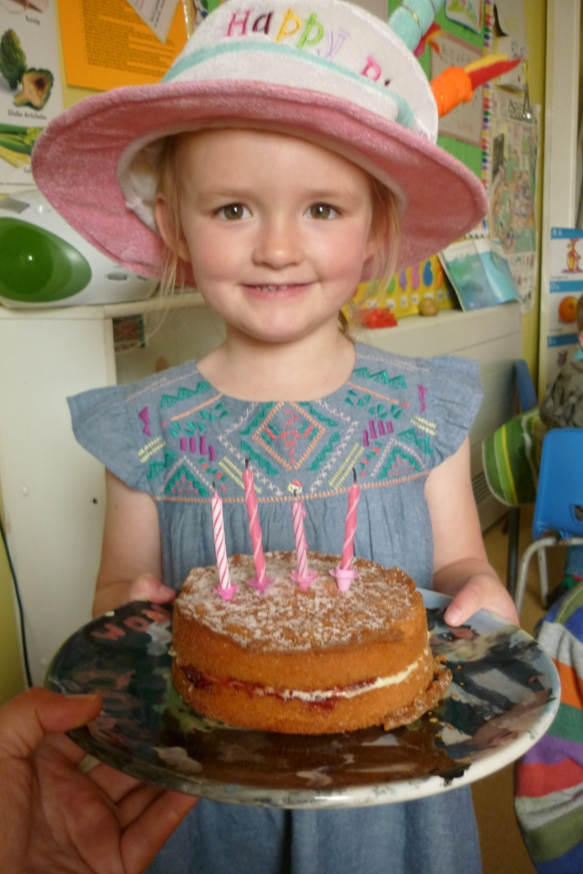 Maggie's birthday was in August. She has four candles on her cake now!!