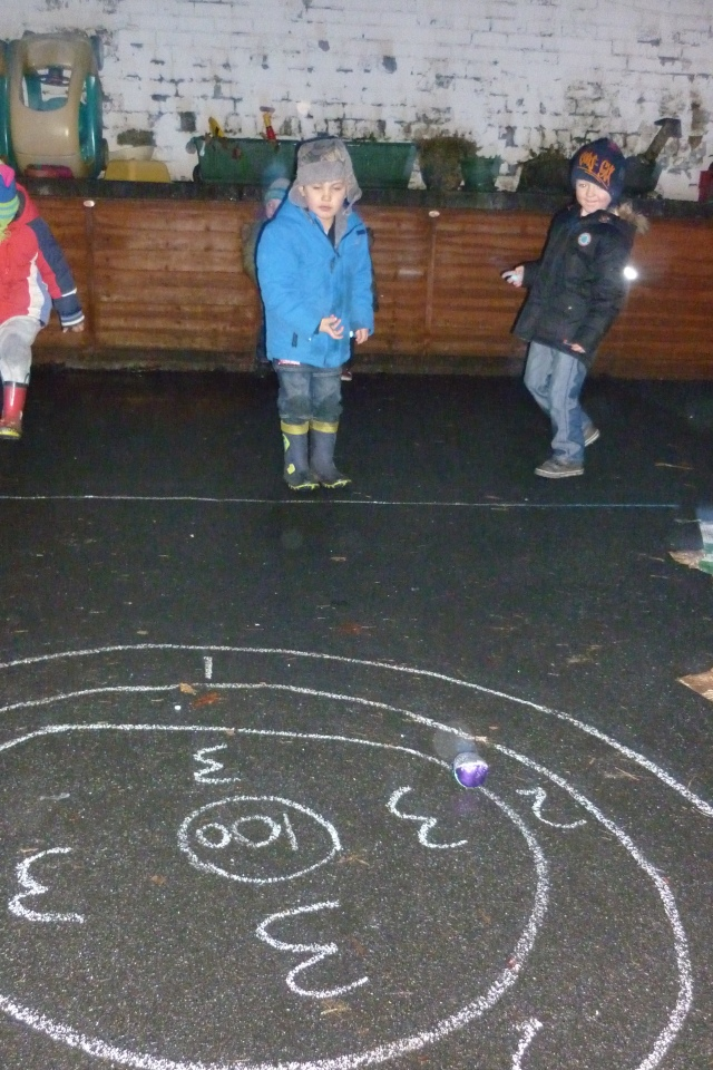 Here are some of our Superheroes having fun with target practise. The children were challenged to add numbers together and mark them onto a score board. This involved them working co-operatively together, taking turns to throw and helping each other out.