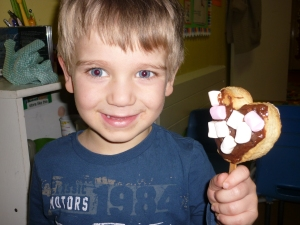 "Here is Alex with his valentine lolly biscuit made for a special treat. ""I want to make one for my Helena too"""