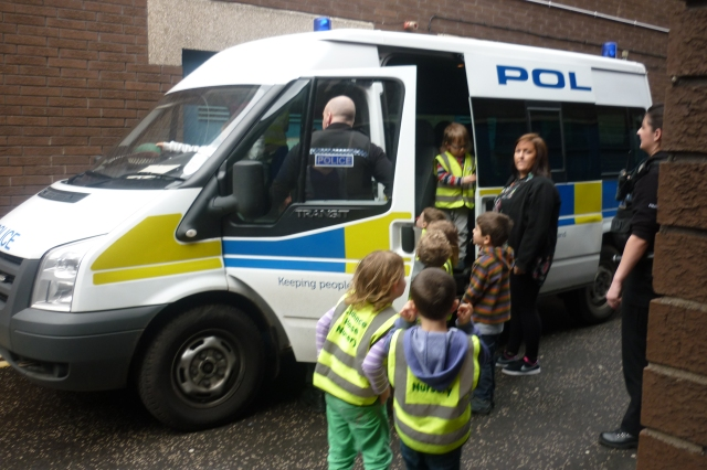 "Here we are looking inside the big police van. ""It had 7 seats"" - Archie ""I like it when Alex put on the handcuffs"" - Arthur ""When I was sitting at the back of the police van I learned how to put my seatbelt on"" - Maggie"