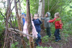 We came to check on the seeds we planted a few weeks ago. We have also decorated some logs with paint and will take them along soon. We all love playing in the Children's Wood and enjoy all the activities held there.