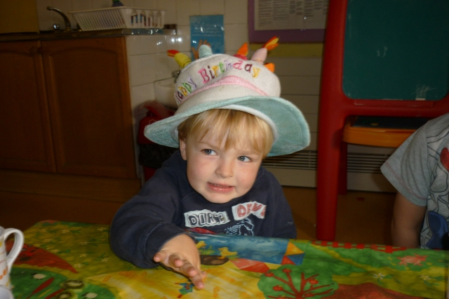 Yes, we were surprised he wanted to wear he hat as well!! There was a cake but it didn't last long.