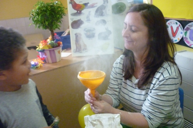 """This provided at least an hour of fun and hysterics one day last week. Flour in the funnel (which is attached to a balloon).Squeeze the balloon and hey presto a flour cloud. What was supposed to have been made was """"feely bees)!!."""