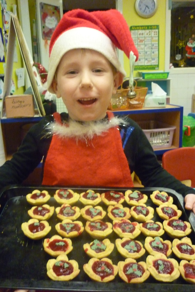 We did ofcourse!! We made these cranberry pies from scratch. We made the sauce and the biscuit part. Then we made a Christmas Cafe for our families and served them up on a plate.