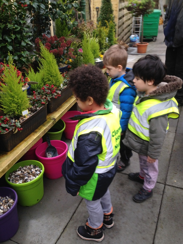 This is us at Anniesland Pet and Garden Centre. We came here to help choose some young plants that we plan to plant in the Children's Wood next week. The man who served us gave us a bird feeder for our garden and told us to watch out for Goldfinches.