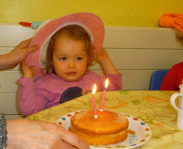 She loved the cake.  Loved the hat. Loved the song. Yeah it was party time!!!