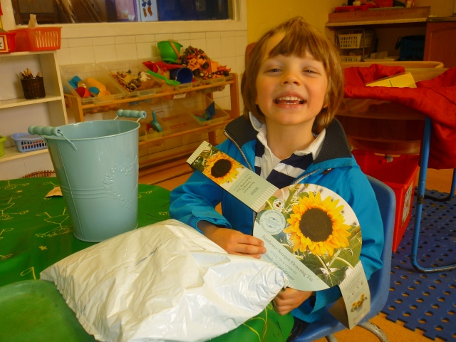 We have been doing loads of planting and growing these past few weeks. We planted our apple tree in the Meadow, also some bedding plants there too. We have planted tomato plants and runner beans. Now we have some sunflower seeds growing. How happy does Sandy look?